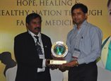Dr JA Jayalal (Left) felicitates Prof Sunil Abraham (right), First Prof of Family Medicine in India from CMC Vellore